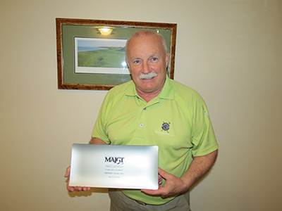Larry Myers holding MAJGT Appreciation Plaque